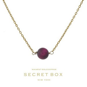 "Secret Box 14 karat gold dipped over brass necklace with a fuchsia bead pendant. Approximately 16"" in length."