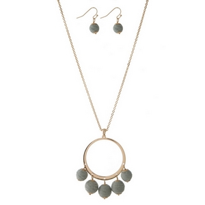 """Gold tone necklace set with an open circle pendant, gray thread wrapped wrapped bead fringe, and matching fishhook earrings. Approximately 32"""" in length."""