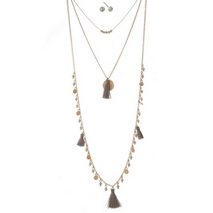 "Gold tone three layer necklace with gray beads and tassels. Approximately 14"" to 32"" in length."