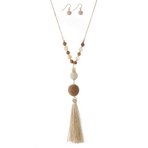 """Gold tone necklace set with ivory and tan thread wrapped beads and a two tone thread tassel. Approximately 30"""" in length."""