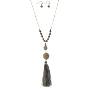"""Gold tone necklace set with two tone thread wrapped beads and a two tone thread tassel. Approximately 30"""" in length."""