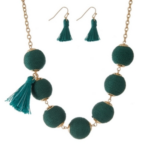"""Gold tone necklace set with emerald green thread wrapped beads, tassel accents and matching fishhook earrings. Approximately 16"""" in length."""