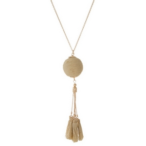 """Gold tone necklace with a metallic gold thread wrapped pendant and thread tassels. Approximately 30"""" in length."""