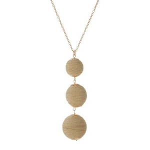 """Gold tone necklace with three, metallic gold thread wrapped beads. Approximately 30"""" in length."""