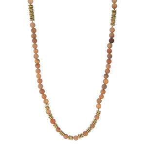 "Waxed cord necklace with peach druzy natural stone beads and gold tone accents. Adjustable up to 40"" in length. Handmade in the USA."