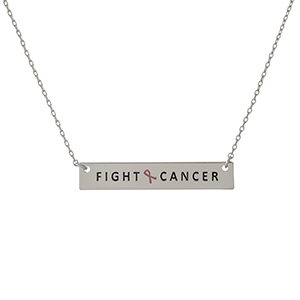 "Dainty silver tone, Breast Cancer Awareness necklace with a bar pendant, stamped with ""Fight Cancer."" Approximately 16"" in length."
