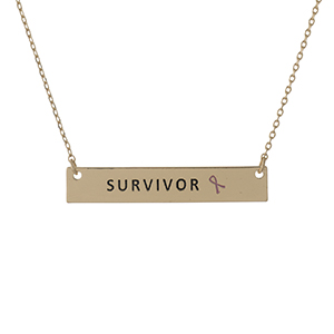 "Dainty gold tone, Breast Cancer Awareness necklace with a bar pendant, stamped with ""Survivor."" Approximately 16"" in length."