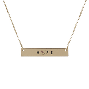 "Dainty gold tone, Breast Cancer Awareness necklace with a bar pendant, stamped with ""Hope."" Approximately 16"" in length."