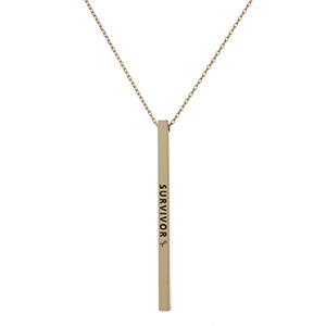 "Dainty gold tone, Breast Cancer Awareness necklace with a vertical bar pendant, stamped with ""Survivor."" Approximately 18"" in length."