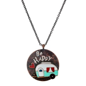 """Rustic copper tone necklace with a circle pendant, stamped with """"Be Happy"""" and a camper accent. Approximately 33"""" in length."""