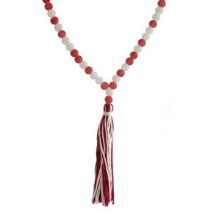 "Beaded gameday necklace with a yarn tassel pendant. Approximately 30"" in length."