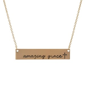 """Dainty gold tone necklace with a bar pendant, stamped with """"Amazing Grace."""" Approximately 16"""" in length."""