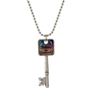 """Silver tone necklace with a key pendant that says """"Believe in Yourself."""" Approximately 26"""" in length."""