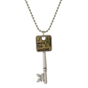 """Silver tone necklace with a key pendant that says """"Enjoy the Journey."""" Approximately 26"""" in length."""