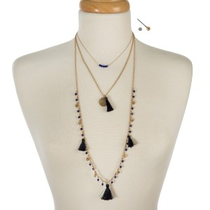 "Gold tone three layer necklace with navy blue beads and tassels. Approximately 14"" to 32"" in length."