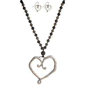 """Faux leather cord necklace set with natural stone beads, a heart pendant and matching fishhook earrings. Approximately 30"""" in length."""