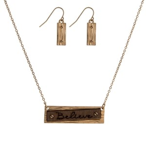 """Dainty necklace set with a geometric shaped and wooden pendant stamped with """"Believe"""" and matching fishhook earrings. Approximately 16"""" in length."""