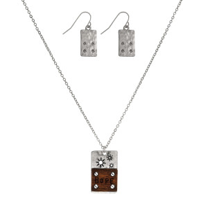 """Dainty necklace set with a geometric shaped and wooden pendant stamped with """"Hope"""" and matching fishhook earrings. Approximately 16"""" in length."""
