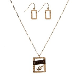 """Dainty necklace set with a geometric shaped and wooden pendant stamped with """"Blessed"""" and matching fishhook earrings. Approximately 16"""" in length."""