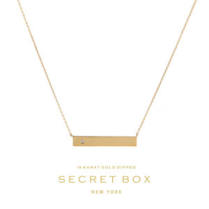 """Secret Box 14 karat gold over brass bar pendant necklace with a clear rhinestone accent. Approximately 16"""" in length."""