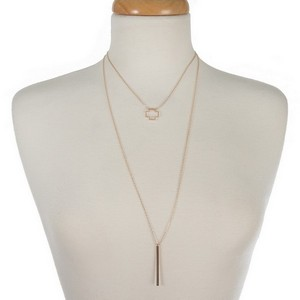 """Dainty two layer necklace with a cross and bar pendant. Approximately 16"""" and 26"""" in length."""