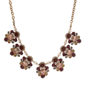 "Gold tone statement necklace with clusters of burgundy and topaz rhinestones. Approximately 16"" in length."