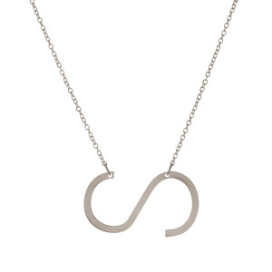 """Dainty silver tone necklace with a 1.5"""" sideways, initial pendant. Approximately 16"""" in length."""