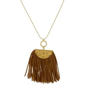 "Burnished gold tone necklace with a suede tassel pendant. Approximately 30"" in length."