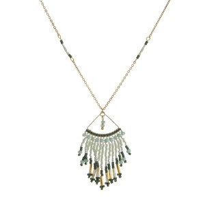 "Dainty gold tone necklace with a beaded, fringe pendant. Approximately 16"" in length."