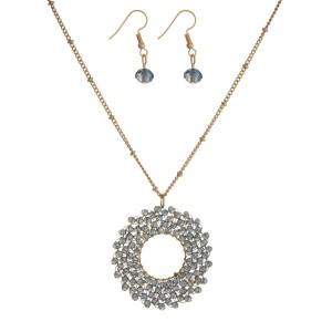 "Gold tone necklace set with a beaded, open circle pendant and matching fishhook earrings. Approximately 30"" in length."