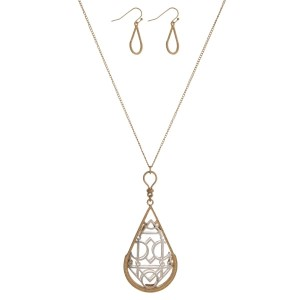 "Gold tone necklace with a filigree, teardrop shaped pendant and matching fishhook earrings. Approximately 30"" in length."