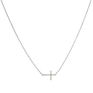 "Dainty metal necklace with a sideways cross pendant and clear rhinestones. Approximately 16"" in length."