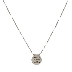 "Dainty metal necklace with a circle pendant, stamped with ""With God All Things Are Possible."" Approximately 16"" in length."