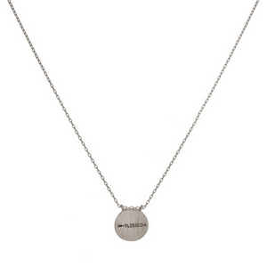 """Dainty metal necklace with a circle pendant stamped with an arrow and """"Blessed."""" Approximately 16"""" in length."""