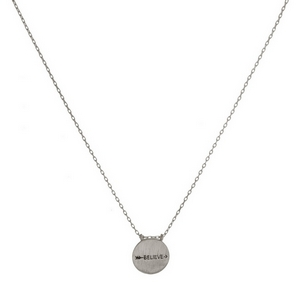 """Dainty metal necklace with a circle pendant stamped with an arrow and """"Believe."""" Approximately 16"""" in length."""