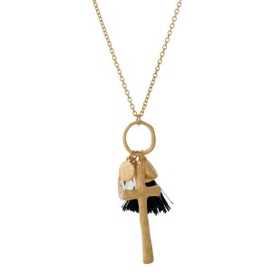 """Long, metal necklace with a tassel and rhinestone pendant. Approximately 30"""" in length."""
