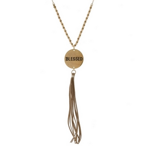 "Dainty necklace with a coin pendant, stamped with ""Blessed"" and accented by a faux leather tassel. Approximately 32"" in length."