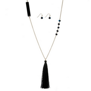 """Gold tone necklace set with beaded accents along the chain, a thread tassel pendant and matching fishhook earrings. Approximately 30"""" in length."""