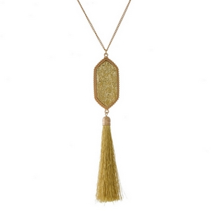 "Gold tone necklace set with a faux druzy and thread tassel pendant. Approximately 26"" in length."