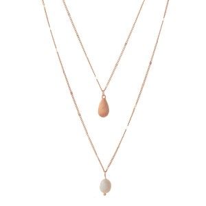 """Dainty, two layer necklace with a freshwater pearl bead pendant. Approximately 22"""" and 32"""" in length."""