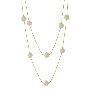 """Gold tone wrap necklace with pearl bead stationaries. Approximately 60"""" in length."""
