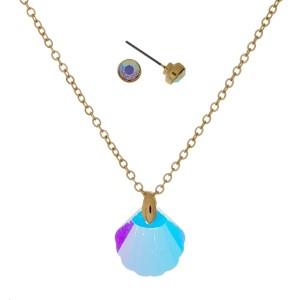 "Dainty necklace set with an iridescent seashell pendant and matching stud earrings. Approximately 16"" in length."