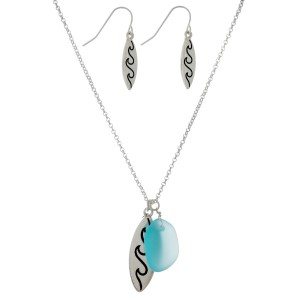 "Dainty necklace set with a wave and sea glass pendant. Approximately 16"" in length."
