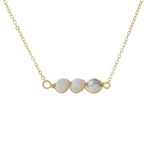 """Dainty, gold tone necklace with wire-wrapped natural stone beads. Approximately 16"""" in length. Natural stone colors may vary."""