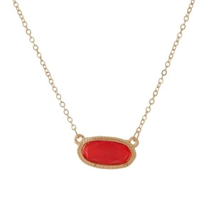 """Dainty, gold tone necklace with an oval shaped, faceted stone pendant. Approximately 16"""" in length."""
