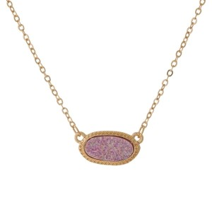 "Dainty, gold tone necklace with an oval shaped, faux druzy pendant. Approximately 16"" in length."