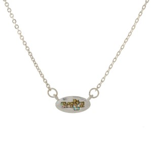 "Dainty metal necklace with a small rhinestone cross pendant. Approximately 16"" in length."