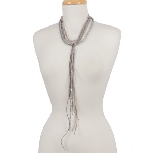 """Faceted bead and faux suede, multi layer, 'Y' necklace. Approximately 16"""" in length."""