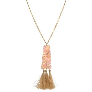 "Gold tone necklace with a rectangle acetate pendant and thread tassels. Approximately 30"" in length."