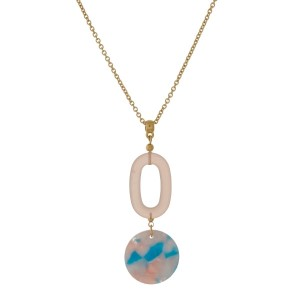 """Gold tone necklace with a two-tone, two piece, acetate pendant. Approximately 30"""" in length."""